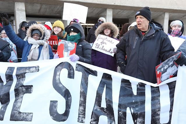 """Protesters hold signs while participating in """"Take a Knee"""" rally by Black Lives Matter and other groups in Minneapolis, Minnesota, U.S., February 4, 2018, near the stadium where the Super Bowl is played. REUTERS/Matt Blewett NO RESALES. NO ARCHIVE."""