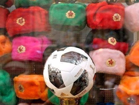 A replica of the FIFA World Cup ball is displayed in front of Russian style hats in a shop window in central Moscow, Russia, July 3, 2018. REUTERS/John Sibley