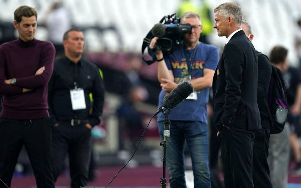 Manchester United manager Ole Gunnar Solskjaer (right) speaks to the press prior to kick-off during the Premier League match at the London Stadium, London - PA
