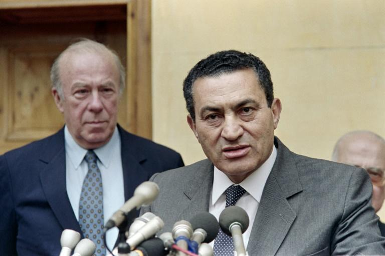 Egypt's then-president Hosni Mubarak speaks after meeting US Secretary of State George Shultz in Cairo in April 1988
