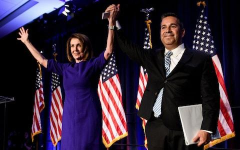 Nancy Pelosi at a victory party in Washington - Credit: AFP