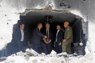 Israeli Foreign Minister Ashkenazi speaks to his Czech counterpart Kulhanek and Slovak counterpart Korcok as they visit the site of a building damaged by a rocket launched from the Gaza Strip last week, in Petah Tikva