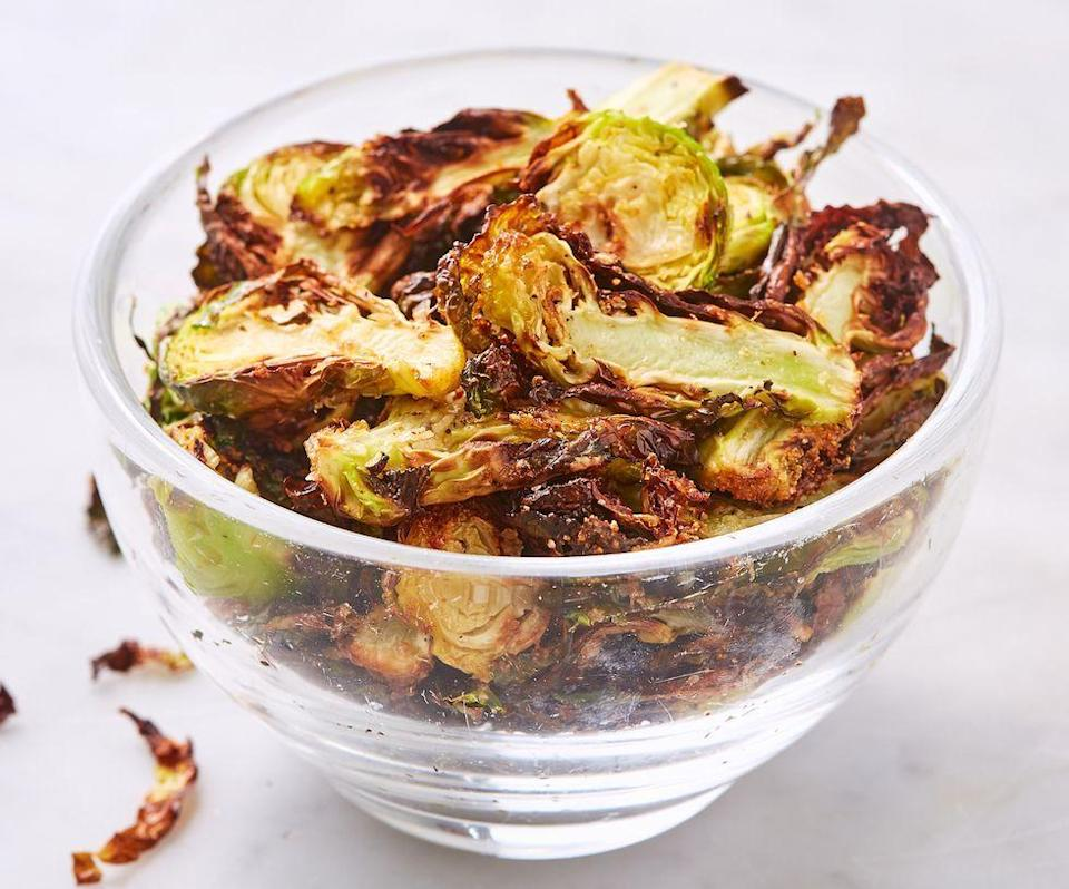 """<p>An air fryer can turn a highly healthy vegetable into a crunchy treat everyone will love.</p><p><a href=""""https://www.delish.com/cooking/recipe-ideas/a19673558/best-brussels-sprout-chips-recipe/"""" rel=""""nofollow noopener"""" target=""""_blank"""" data-ylk=""""slk:Get the recipe from Delish >>"""" class=""""link rapid-noclick-resp""""><em>Get the recipe from Delish >></em></a></p>"""