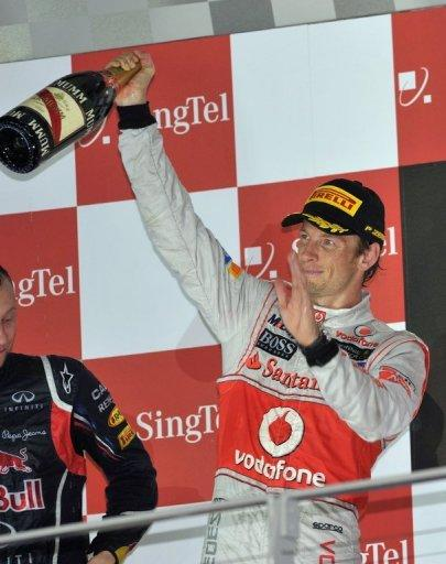 """Jenson Button on the podium at the Singapore Grand Prix on September 23. """"Having (the F1) in Austin is great because it's a very young city and that's what we need, to get young fans into the sport,"""" Button said. """"That's the way to grow the sport in the States and hopefully we will do that."""""""
