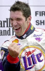 Max Papis celebrates after winning the 2000 CART season opener at Homestead-Miami Speedway. (Photo: Roberto Schmit/AFP via Getty Images)