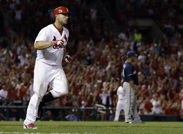 St. Louis Cardinals' Matt Holliday, left, rounds the bases after hitting a two-run home run off Milwaukee Brewers starting pitcher Wily Peralta during the sixth inning of a baseball game Tuesday, Sept. 10, 2013, in St. Louis. (AP Photo/Jeff Roberson)