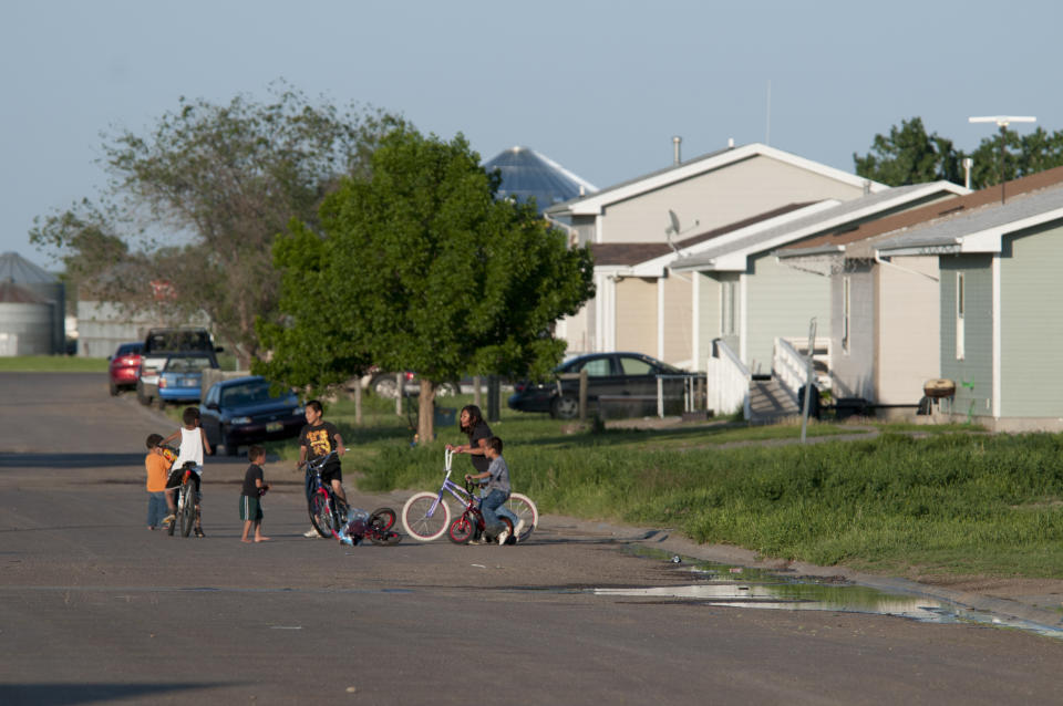 Children playing on a street in a housing development in Poplar, Montana on the Ft. Peck Indian Reservation. The tribes on the reservation are Assiniboine and Sioux. (Photo by William Campbell/Corbis via Getty Images)