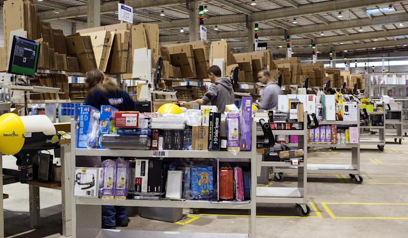 Employees work at the site of the online retailer Amazon on December 13, 2012 in Chalon-sur-Saone, France
