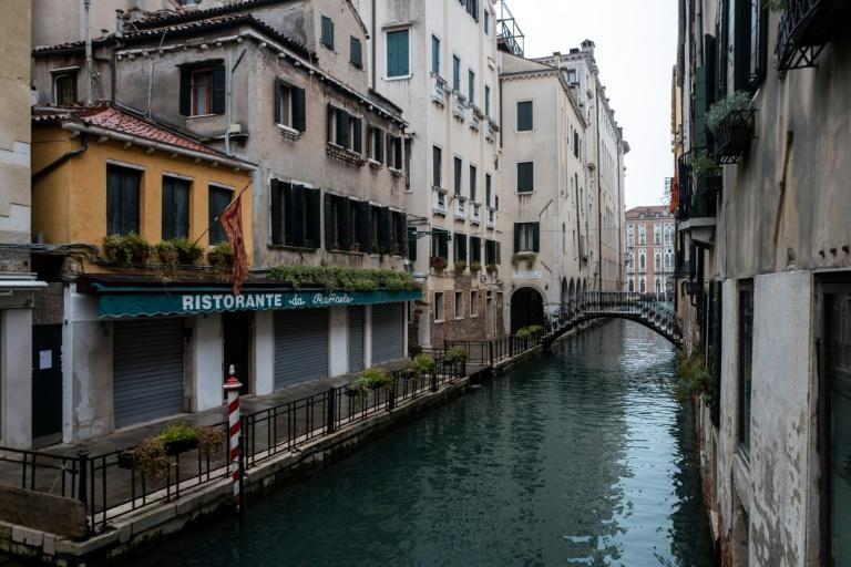 A closed restaurant in Venice. Nearly 100,000 companies in Italy's tourism sector are at risk of bankruptcy, according to the research institute Demoskopika, with a potential loss of 440,000 jobs.