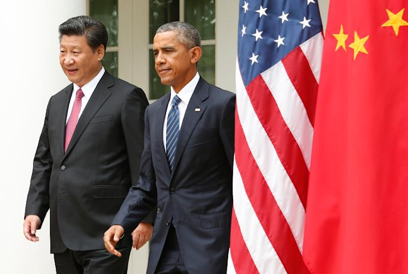 US President Barack Obama and Chinese President Xi Jinping arrive for a joint-press conference in the Rose Garden as part of a State Visit at the White House in Washington, DC, September 25, 2015 (AFP Photo/Yuri Gripas)