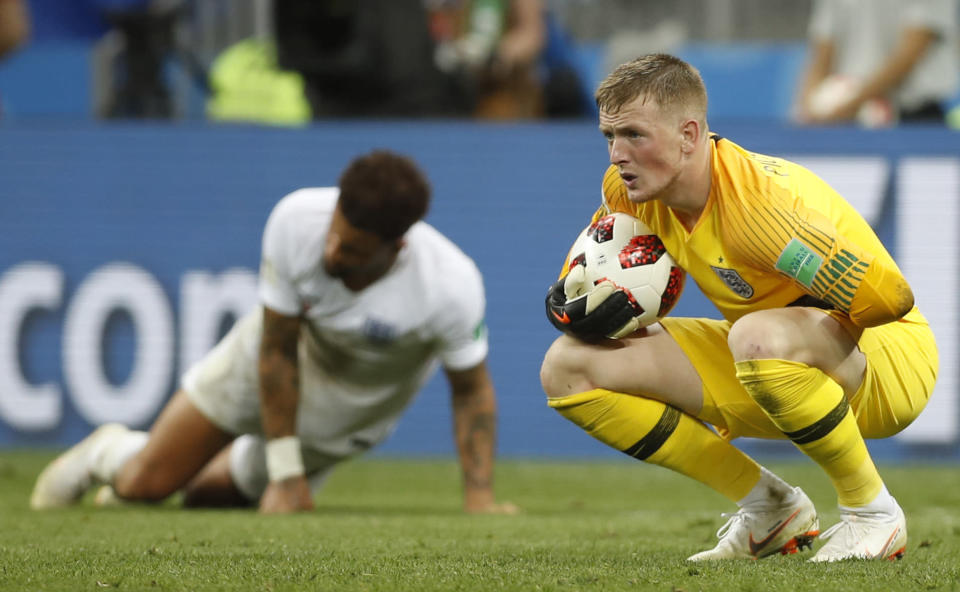 <p>Jordan Pickford holds the ball after failing to make a save against Ivan Perisic, luckily the follow up shot was tame </p>