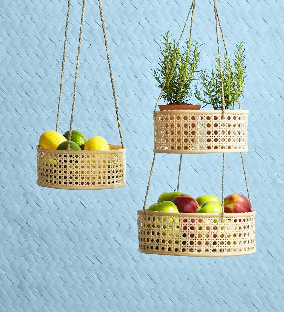 <p>Store fruits or herbs in these sweet DIY baskets that will add charm and storage to your kitchen.</p><p><strong>To make: </strong>Cut a 3 1/2-inch-tall strip of caning slightly longer than the circumference of a wood round. Hot-glue the bottom edge of the strip around the outside edge of the wood to create the sides of the basket. Thread twine through caning (three or four lengths, evenly spaced), and attach with hot-glue, leaving plenty of length to thread through a second basket, if desired. Hot-glue lengths of flat reed around the top and bottom of the basket. Tie twine together at the top to hang.<br></p>