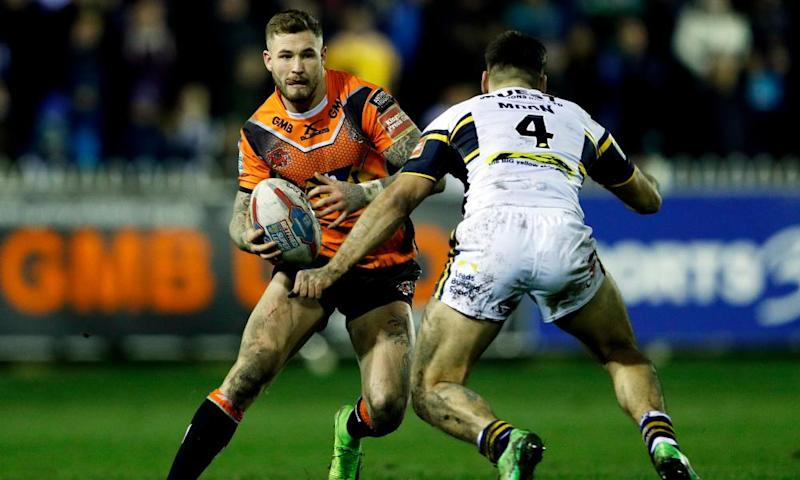 Castleford's Zak Hardaker takes on Joel Moon of Leeds Rhinos during Castleford's crushing win at The Mend-A-Hose Jungle.
