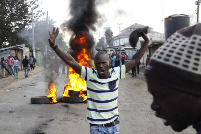 <p>Supporters of Kenyan opposition leader and presidential candidate, Raila Odinga, demonstrate blocking roads with burning tyres in the Kibera slum area in Nairobi, Kenya. Wednesday Aug. 9, 2017. Odinga says hackers infiltrated the database of the country's election commission and manipulated the results. Early results show President Uhuru Kenyatta with a wide lead over Odinga. (Photo: Khalil Senosi/AP) </p>