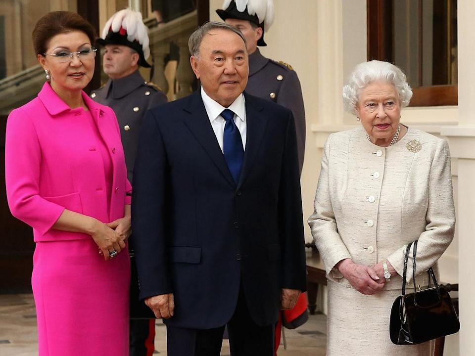 Dariga Nazarbayeva and her father president Nursultan Nazarbayev with Queen Elizabeth at Buckingham Palace in November 2015: Chris Jackson/AFP via Getty Images