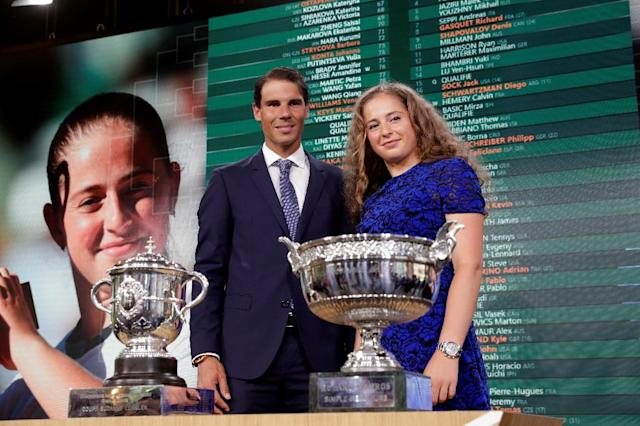 Champions return: Rafael Nadal and Jelena Ostapenko with their French Open trophies at Thursday's draw (AFP Photo/Thomas SAMSON)