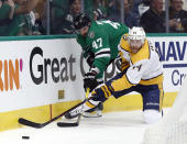 Dallas Stars right wing Alexander Radulov (47) and Nashville Predators defenseman Mattias Ekholm (14) compete for control of the puck in the first period of Game 3 in an NHL hockey first-round playoff series in Dallas, Monday, April 15, 2019. (AP Photo/Tony Gutierrez)
