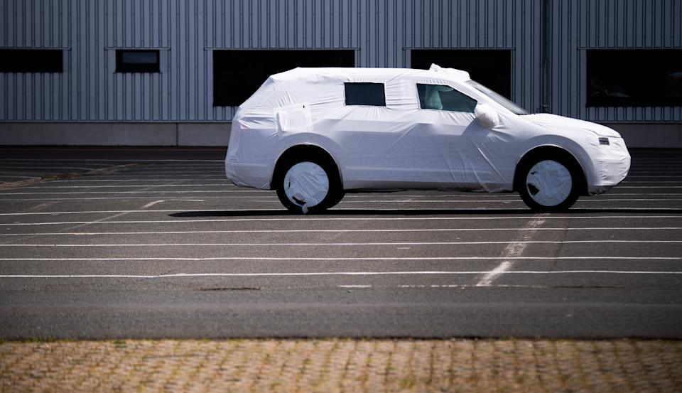 15 May 2020, Lower Saxony, Hanover: A packaged new VW vehicle is parked in a car park at the Volkswagen Commercial Vehicles plant. As expected, the Volkswagen Group has come under heavy pressure due to the corona sales restrictions. Worldwide the group brands delivered 473,500 vehicles in April, 45.4 percent less than in the same month last year. The corona crisis has plunged the entire German economy into recession. Photo: Julian Stratenschulte/dpa (Photo by Julian Stratenschulte/picture alliance via Getty Images)