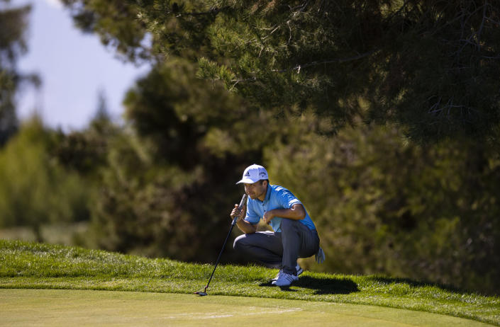 Xander Schauffele lines up a putt on the fifth green during the third round of the CJ Cup golf tournament at Shadow Creek Golf Course, Saturday, Oct. 17, 2020, in North Las Vegas. (Chase Stevens/Las Vegas Review-Journal via AP)