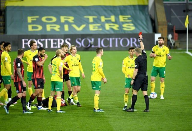 Dimitris Giannoulis was sent off for Norwich before Bournemouth came back to claim victory