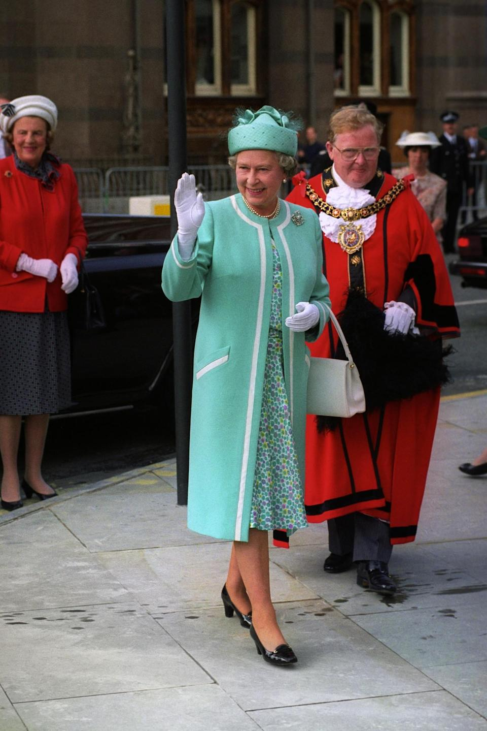 <p>The Queen visits Manchester to open the new Metrolink Tram System. (PA Archive) </p>