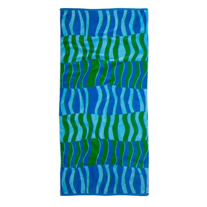 """Well, if this isn't the dopest beach towel we've seen in a while. $65, Brooklinen. <a href=""""https://www.brooklinen.com/products/beach-towel?"""" rel=""""nofollow noopener"""" target=""""_blank"""" data-ylk=""""slk:Get it now!"""" class=""""link rapid-noclick-resp"""">Get it now!</a>"""