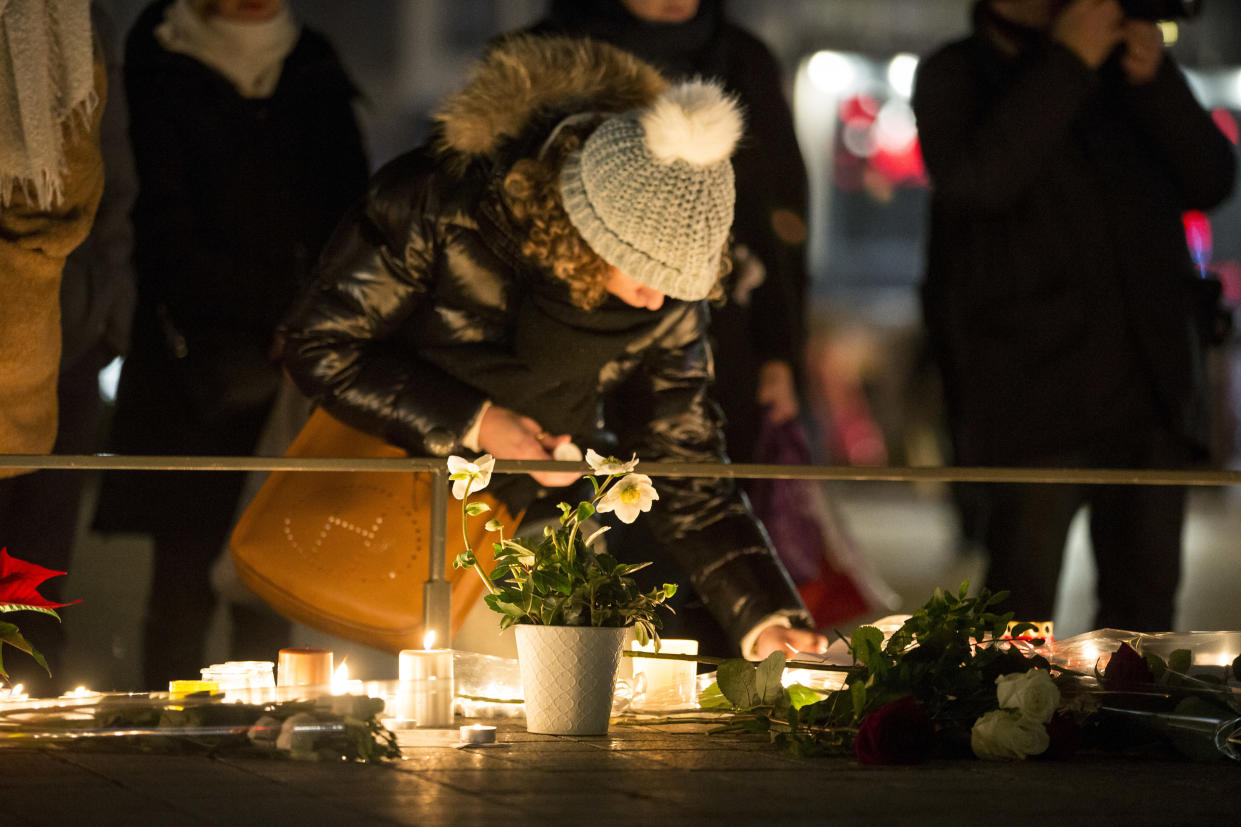 A Mourner seen lighting a candle at the Christmas market in Strasbourg France, on Dec. 12, 2018. Mourners gathered near the Strasbourg Christmas market where candles had been lit in remembrance of the victims. (Photo by Elyxandro Cegarra/SOPA Images/LightRocket via Getty Images)