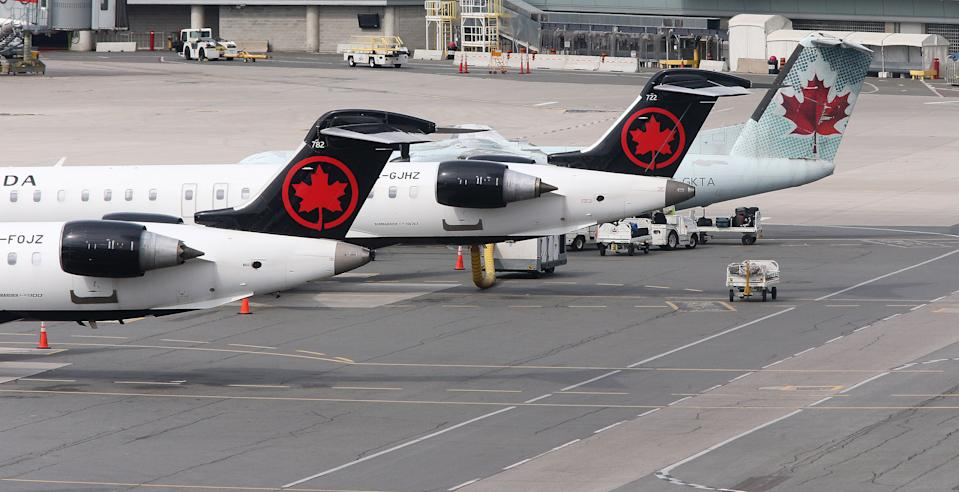Toronto, ON- September 25 - Air Canada planes sit on the tarmac at the airport. Passengers arriving on international flights go through COVID-19 testing at terminal 3 at Toronto Pearson International Airport in Toronto. September 25, 2021. (Steve Russell/Toronto Star via Getty Images)