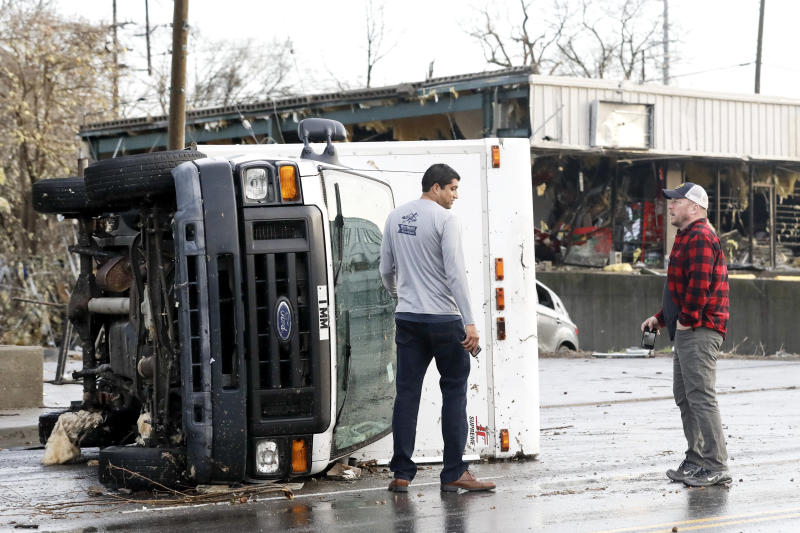 An overturned truck sits in a street in an area damaged by storms in Nashville.