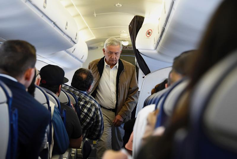 Mexico President Andres Manuel Lopez Obrador always travels by commercial flights, even sitting in economy class (AFP Photo/Alfredo ESTRELLA)