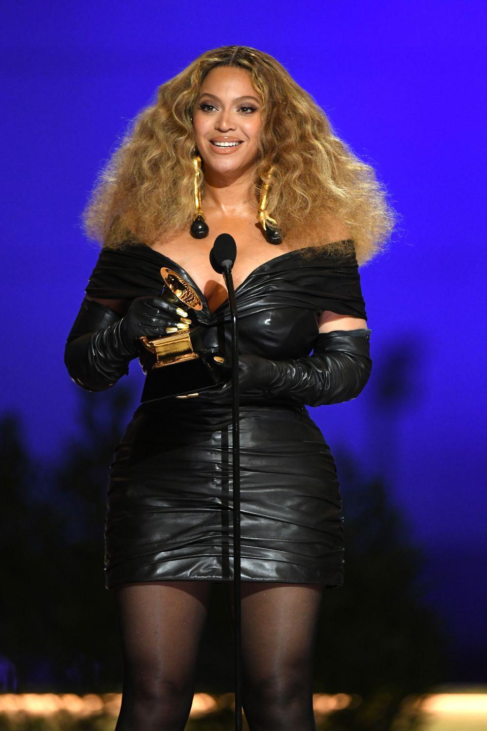 <p>She made history on the night by becoming the most decorated female artist ever after winning her 28th Grammy – and Beyoncé certainly dressed for the occasion. The singer impressed in an off-the-shoulder leather mini dress by Schiaparelli couture, which she teamed with matching leather opera gloves (complete with a painted gold manicure) and statement earrings from the brand.</p>