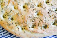 """<p>Everyone will be impressed with this homemade holiday bread. Slice it up and serve it with a cheese board or your favorite soup. </p><p><a href=""""https://www.thepioneerwoman.com/food-cooking/recipes/a91160/simple-rosemary-focaccia/"""" rel=""""nofollow noopener"""" target=""""_blank"""" data-ylk=""""slk:Get the recipe."""" class=""""link rapid-noclick-resp""""><strong>Get the recipe. </strong></a> </p>"""