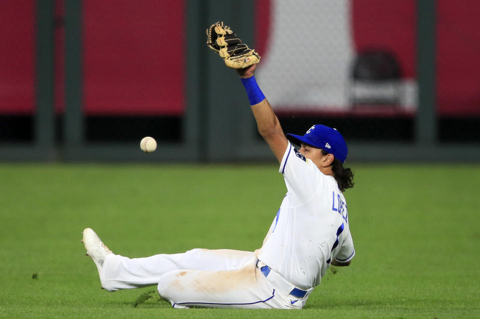 A ball hit by Chicago Cubs Anthony Rizzo gets past Kansas City Royals second baseman Nicky Lopez (1) for a single during the sixth inning of a baseball game at Kauffman Stadium in Kansas City, Mo., Wednesday, Aug. 5, 2020. (AP Photo/Orlin Wagner)
