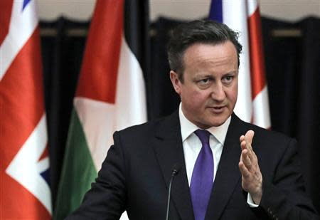 British Prime Minister Cameron gestures as he speaks during a joint news conference with Palestinian President Abbas in Bethlehem