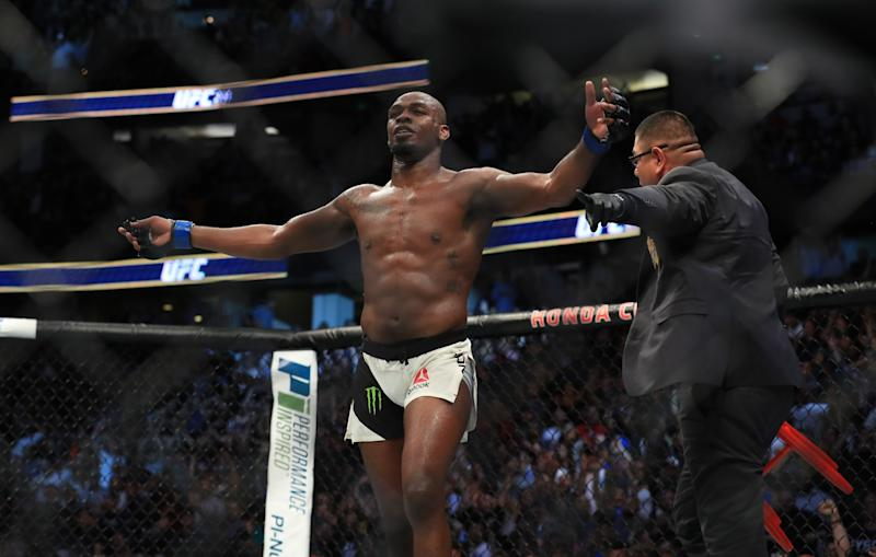 Jon Jones celebrates after knocking out Daniel Cormier in their UFC light heavyweight championship bout during the UFC 214 event at Honda Center on July 29, 2017 in Anaheim, California.