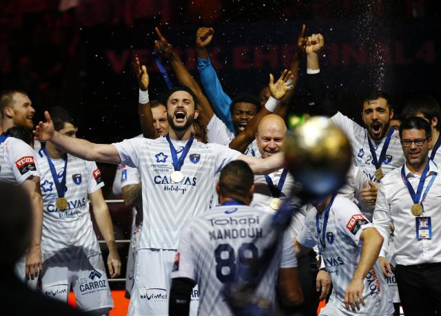 Handball - Men's EHF Champions League Final - HBC Nantes vs Montpellier HB - Lanxess Arena, Cologne, Germany - May 27, 2018. Montpellier HB players celebrate winning the match. REUTERS/Thilo Schmuelgen