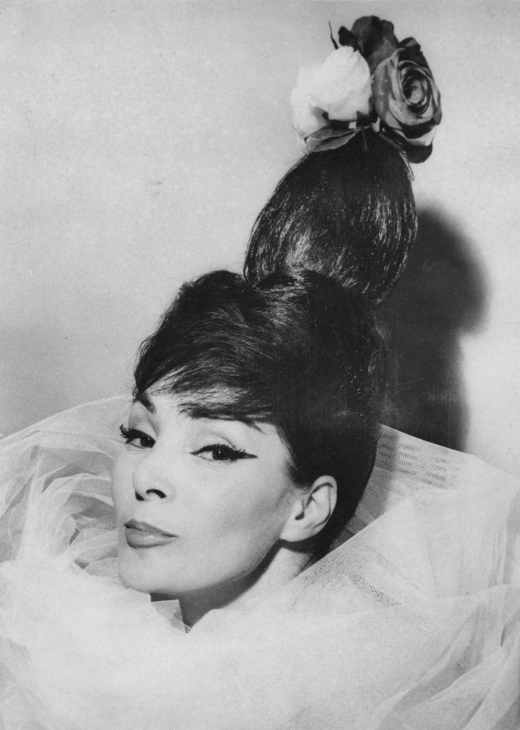 "<p>French model Lucie Daouphars took the bouffant to new heights, literally, when she modeled the ""Easter egg"" hairdo in 1960. The elaborate hairdo became known for more than just its vertical style, as it was often topped with accessories like roses. </p>"