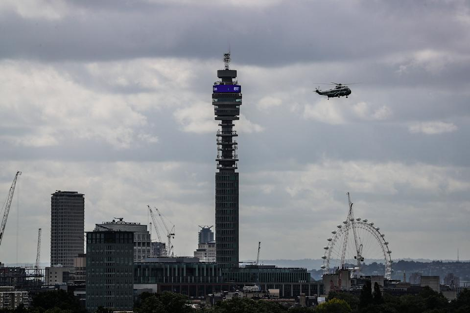 Marine Force One flies over the London skyline carrying President Donald Trump and his wife Melania from Stanstead to central London on Monday morning. (SWNS)