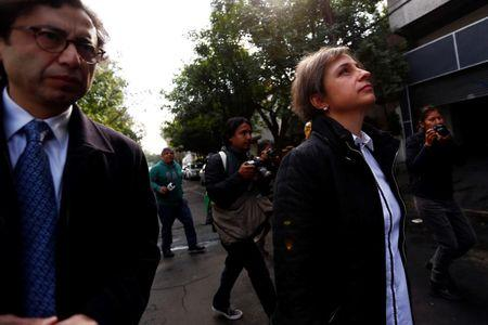 Mexican journalist Carmen Aristegui walks after speaking with journalists outside MVS radio station in Mexico City