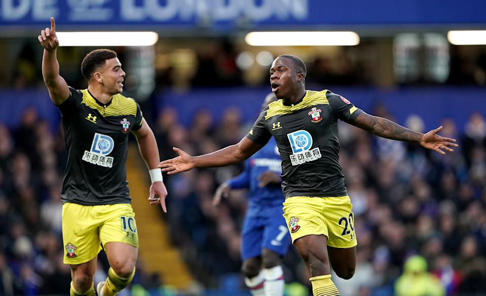 Southampton's Michael Obafemi (right) celebrates scoring his side's first goal of the game  with team-mate Che Adams Chelsea v Southampton - Premier League - Stamford Bridge 26-12-2019 . (Photo by  Tess Derry/EMPICS/PA Images via Getty Images)