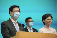From right, Hong Kong's Chief Executive Carrie Lam, Secretary for Security Chris Tang and Chief Secretary John Lee attend a news conference in Hong Kong, Friday, June 25, 2021. China on Friday promoted Hong Kong's top security official to the territory's No. 2 spot as Beijing continues to clamp down on free speech and political opposition. (AP Photo/Kin Cheung)