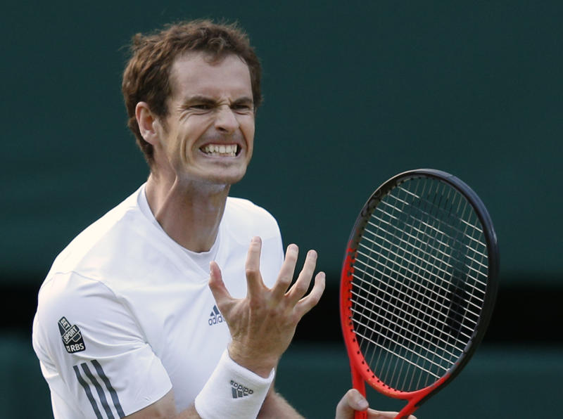 Andy Murray of Britain reacts during a Men's singles quarterfinal match against Fernando Verdasco of Spain at the All England Lawn Tennis Championships in Wimbledon, London, Wednesday, July 3, 2013. (AP Photo/Jonathan Brady)