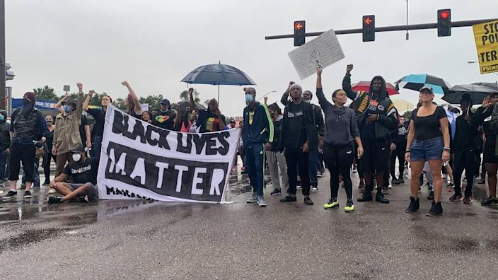 Hundreds of Black Lives Matter marchers occupy the intersection of U.S. 301 and Martin Luther King Jr. Way Wednesday evening in Sarasota as part of a protest calling for police reform in the wake of George Floyd's death.