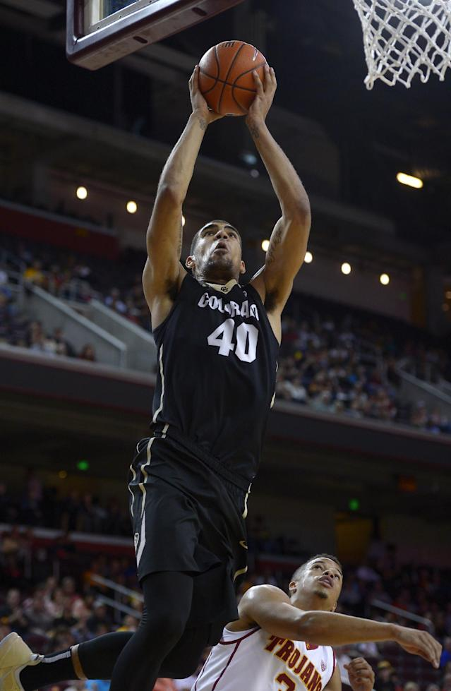 Colorado forward Josh Scott, left, puts up a shot as Southern California guard Chass Bryan defends during the first half of an NCAA college basketball game, Sunday, Feb. 16, 2014, Los Angeles. (AP Photo/Mark J. Terrill)