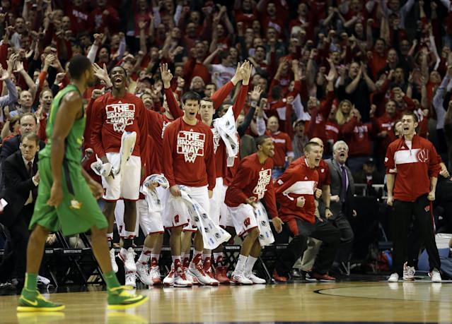 Wisconsin bench react to a foul call against Oregon during the second half of a third-round game of the NCAA college basketball tournament Saturday, March 22, 2014, in Milwaukee. (AP Photo/Jeffrey Phelps)