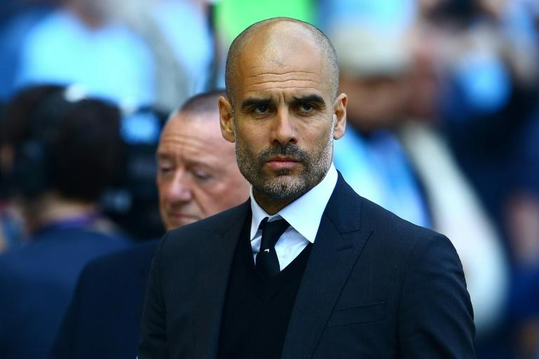 Manchester City's manager Pep Guardiola reacts ahead of the English Premier League football match against Hull City April 8, 2017