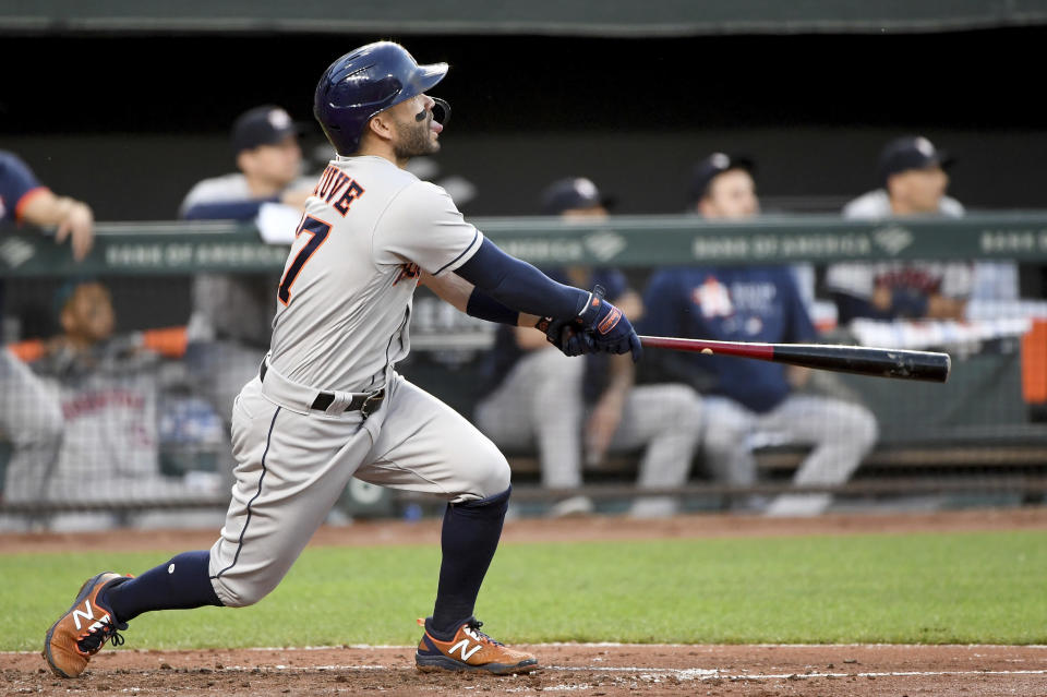 Houston Astros' Jose Altuve hits a two-run home run against the Baltimore Orioles in the fourth inning of a baseball game, Wednesday, June 23, 2021, in Baltimore. (AP Photo/Will Newton)