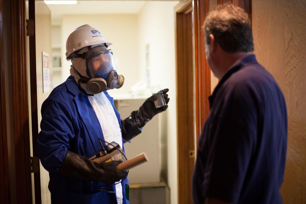 Houston, TX, USA - Steven Vanasse checks for radiation in his house.