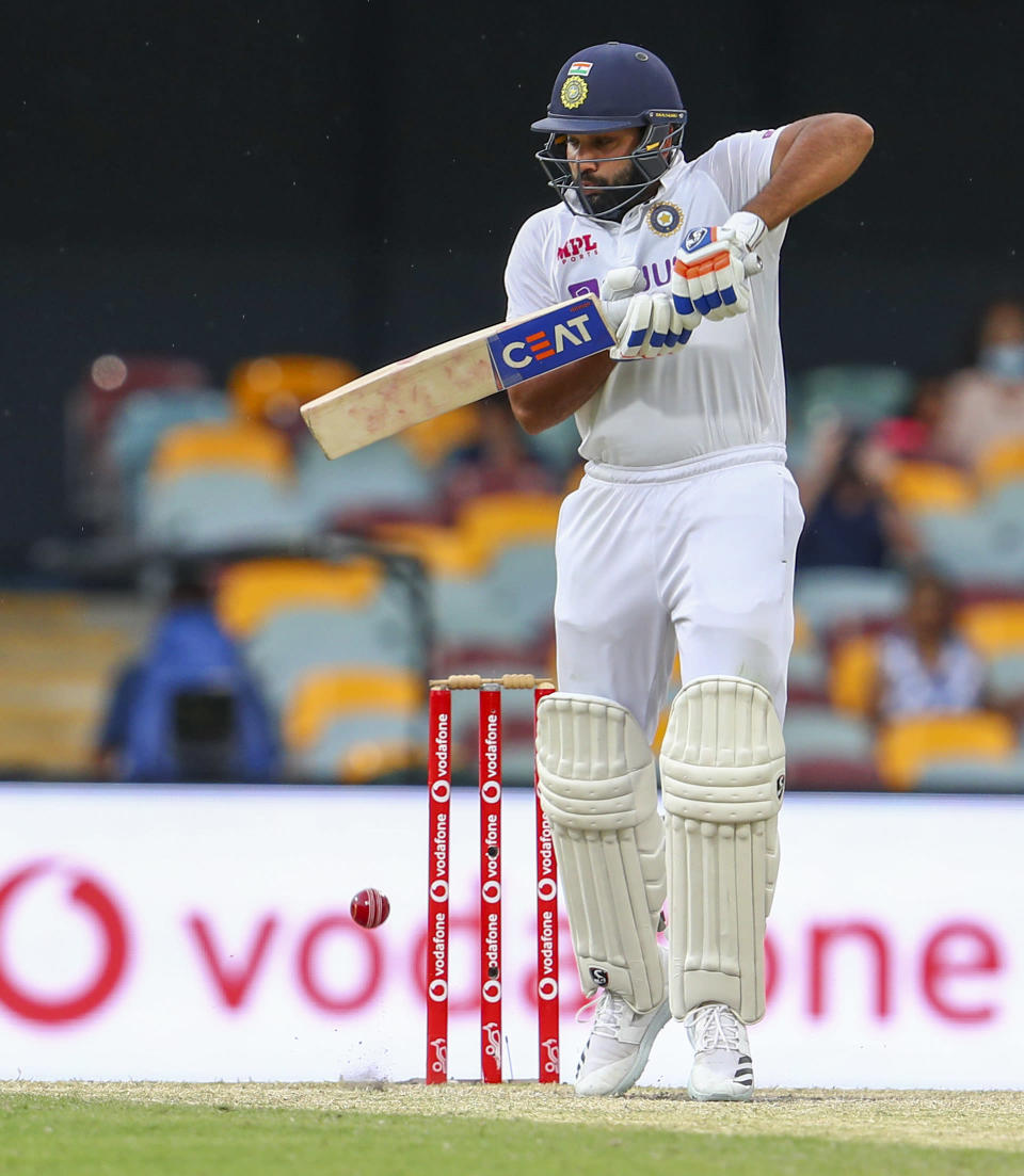 India's Rohit Sharma bats during play on day four of the fourth cricket test between India and Australia at the Gabba, Brisbane, Australia, Monday, Jan. 18, 2021. (AP Photo/Tertius Pickard)