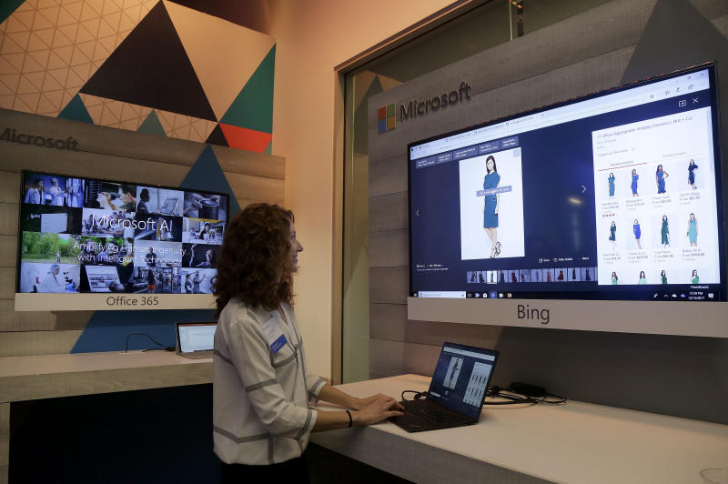 Laura Jones, senior product marketing manager at Microsoft, gives a demonstration of new intelligence search features in Bing at a Microsoft event in San Francisco, Wednesday, Dec. 13, 2017. Microsoft rolled out new features on its Bing search engine powered by artificial intelligence, including one that summarizes the two opposing sides of contentious questions, and another that measures how many reputable sources are behind a given answer. (AP Photo/Jeff Chiu)